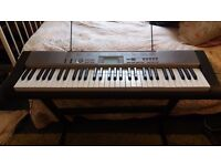 asio LK-120 Electric Keyboard with Light Up Keys - Excellent condition.