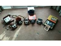 Collection of Cameras and movie cameras.