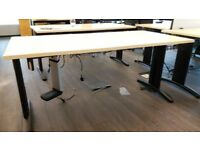 Light wood office desks with partitions & metal racks for cables