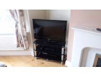 Tv stand - black glass and chrome.