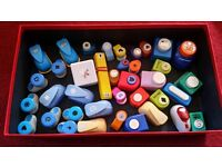 Box of assorted craft punches and embossing tools