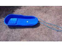 Kid's blue plastic sledge