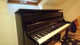 Roland LX15 upright digital piano.