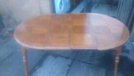 Large Round Extending Dinning Table