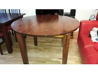 Cargo Round Dark Wood Extendable Dining Table