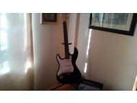 Left hand electric guitar & amp