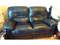 Two seater leather recliner.