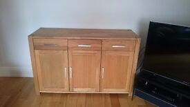 Solid Oak Dining table with 6 brown faux leather chairs and oak sideboard in good condition