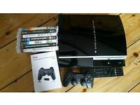 Playstation 3 plus 2 controllers an various games