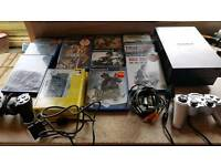 Playstation 2 with games controllers and remote
