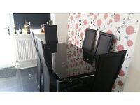 Black glass table (extendable) with 6 faux leather chairs