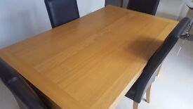 Dining room table and 4 chairs Very good condition. Dismantled now for easy transport.