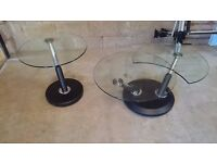 """Circular """"twist"""" expanding glass coffee table with matching glass side table."""