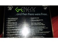 Three Genesis CDs one the deluxe 2 CD Edition