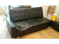 Black, faux leather sofabed
