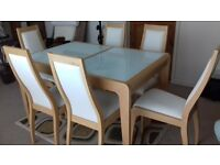 Contemporary solid beech & tempered glass extendable dining table & six chairs in 'as new' condition