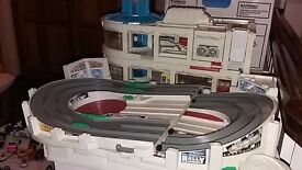 Boys toys including micro machine race track.