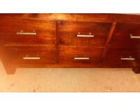 Wooden, dark mahogony colour useful and decortive chest/table. Opens up. 6 drawers. Good condition.