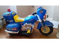 Child's electric police bike in excellent condition.