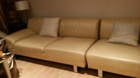 Pair of Cream Leather Sectional Sofas
