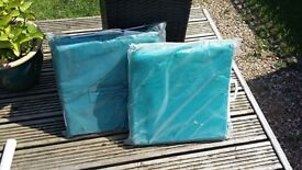Set of unused garden chair cushions in beautiful teal colour