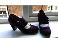 Woman's purple heels