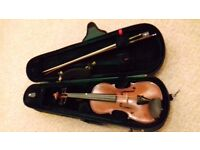 Stentor 1/2 size child's violin. Great brand. Great condition. Perfect for beginner.
