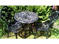Ornate garden table and two chairs
