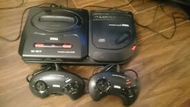 SEGA Megadrive 2 and Mega CD 2 with all cables, 2 controllers and games