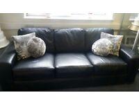 Black large 4 seater leather sofa