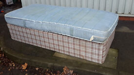 Used single bed with a mattress
