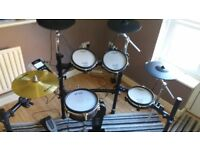 Roland TD9 vdrums. With extra cymbal and Alesis surge hi hats