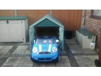 CHILD'S 2 seater electric car with free garage
