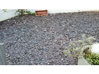 Grey slate pieces for garden decoration or drive
