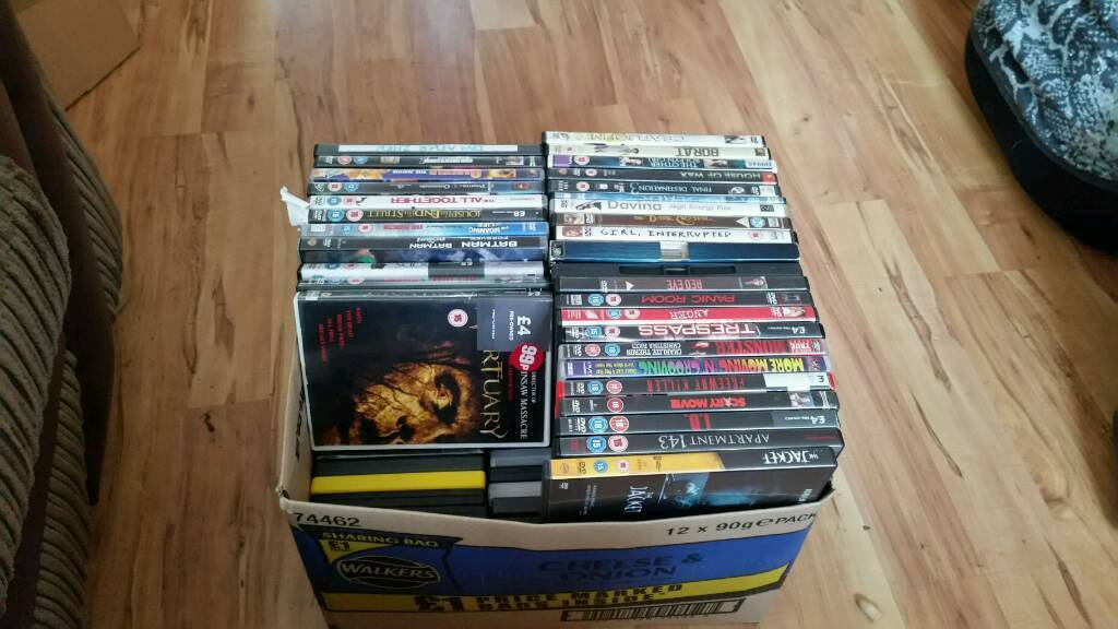 Large box full of dvds all with cases
