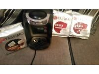 Bosch tassimo coffee machine with 3 packs of pods.