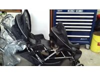 A Childs' Double Buggie - Good condition