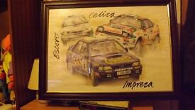 framed picture of 3 wrc cars.