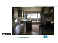 New static caravan sleeps up to 8 people for rent in Blackpool Marton Mere site with all amenities .