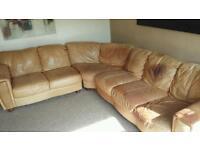 Large tan leather corner sofa.