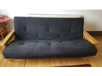Oak futon with extra new cover / 3 seater / black / 2 years old / excellent condition / dbl bed size