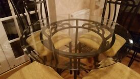 Glass top dining table with 4 tall chairs