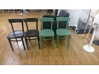 Green and black wooden chairs