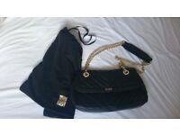 Biba black leather handbag with chain handles.