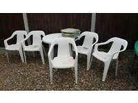 Garden table, 5 chairs & seat pads