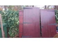 Garage Doors, solid wood and very heavy. Matching side door/gate.