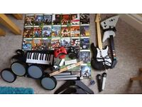 Massive xbox 360 bundle + rockband and guitar hero controllers!