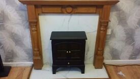 Black electric fire with wooden mantlepiece