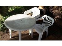 White Plastic Circle Table with 5 Chairs