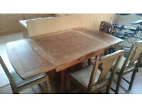 Large, extendable and sturdy wooden table with 4 chairs